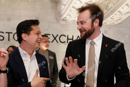 Pinterest co-founder & CEO Ben Silbermann, left, and fellow co-founder and chief product officer Evan Sharp, are photographed on the New York Stock Exchange trading floor, before the company's IPO