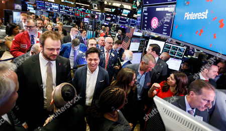 Pinterest CEO Ben Silbermann (2-L) and Evan Sharp (L), the company's co-founder and chief product officer, are seen before the initial public offering for the social media company Pinterest at the New York Stock Exchange in New York, New York, USA, 18 April 2019.