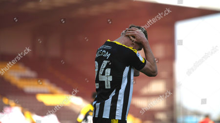 Rob Milsom holds his head after putting in a poor cross for Notts.