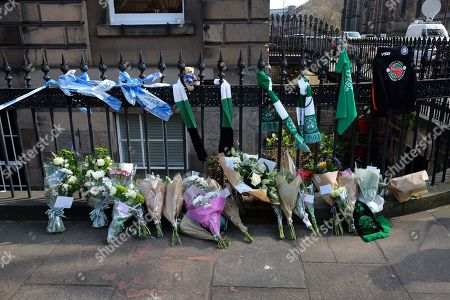 Stock Photo of Hibernian F.C. football club scarfs and flower tributes to Former boxer and Trainspotting T2 actor Bradley Welsh who died after being shot near his home
