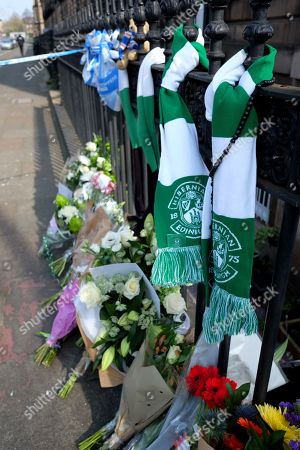 Stock Image of Hibernian F.C. football club scarfs and flower tributes to Former boxer and Trainspotting T2 actor Bradley Welsh who died after being shot near his home