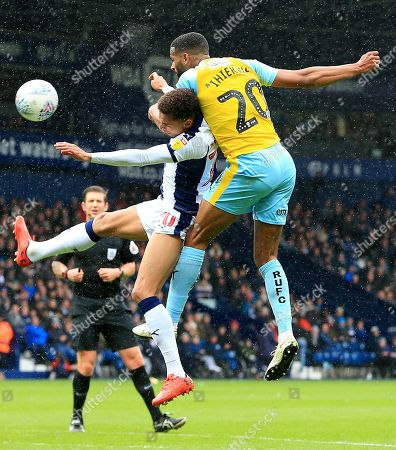 Michael Ihiekwe of Rotherham United wins a header from Jacob Murphy of West Bromwich Albion