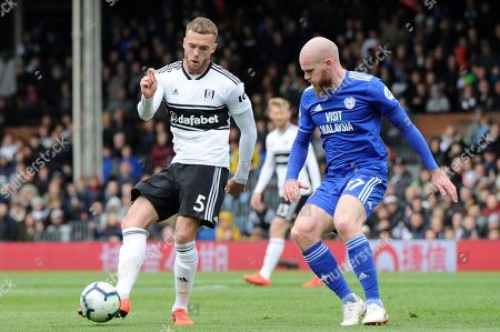Calum Chambers of Fulham and Aron Gunnarsson of Cardiff City in action during the Premier League match between Fulham and Cardiff City at Craven Cottage in London, UK - 27th April 2019