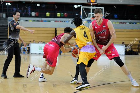 Stock Image of Jonathon James of London Lions and Kiefer Douse (L) Harrison Gamble (R) of Leicester Riders in action during the British Basketball League match between London Lions and Leicester Riders at the Copper Box Arena in London, UK - 28th April 2019