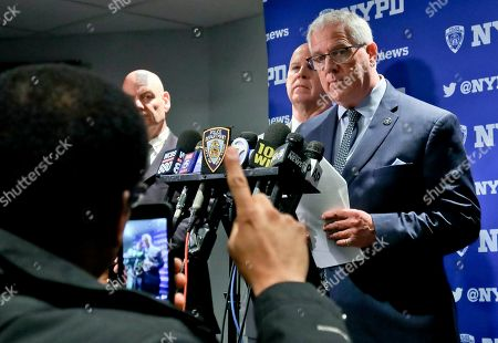Stock Image of New York Police Commissioner James O'Neill, center, and Deputy Commissioner John Miller, right, hold a press conference with the latest into the investigation of suspect charged with attempted arson at St. Patrick's Cathedral, in New York