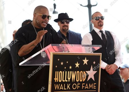 Xzibit, B-Real, DJ Muggs. Xzibit speaks during a ceremony honoring hip-hop group Cypress Hill with a star on the Hollywood Walk of Fame, in Los Angeles. Looking on from right are DJ Muggs and B-Real of Cypress Hill