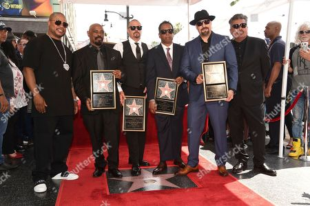 "Sen Dog, DJ Muggs, Eric Bobo Correa, B-Real, Xzibit, George Lopez. Sen Dog, from second left, DJ Muggs, Eric ""Bobo"" Correa and B-Real, of hip-hop group Cypress Hill, pose atop their new star with Xzibit, left, and George Lopez, right, during a ceremony on the Hollywood Walk of Fame, in Los Angeles"