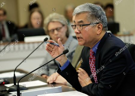 Former Washington Governor Gary Locke testifies during a hearing on Initiative 1000 before a joint Washington state House and Senate committee, at the Capitol in Olympia, Wash. Locke spoke in favor of Initiative 1000, which would allow the state government to use affirmative action policies that do not constitute preferential treatment to remedy discrimination in public employment, education and contracting