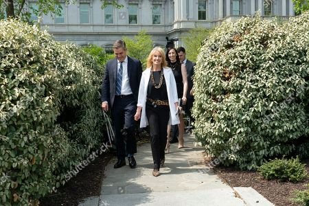 Senior Counselor Kellyanne Conway walks with CNN's Chief Whitehouse Correspondent Jim Acosta after an interview with Fox News about the release of the Mueller report at the White House.