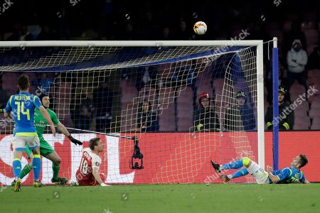 Napoli's Arkadiusz Milik, right, missed chance to score during the Europa League second leg quarterfinal soccer match between Napoli and Arsenal at San Paolo stadium in Naples, Italy