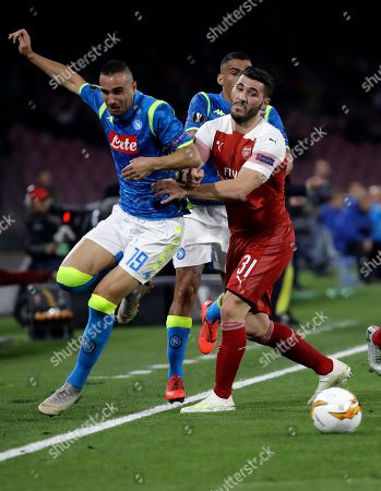 Arsenal's Sead Kolasinac, right, tries to stop Napoli's Arkadiusz Milik during the Europa League second leg quarterfinal soccer match between Napoli and Arsenal at San Paolo stadium in Naples, Italy