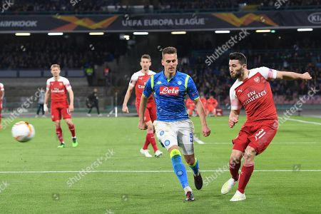 Napoli's Arkadiusz Milik and Arsenal's Sead Kolainac (R) in action during the UEFA Europa League quarterfinal, second leg soccer match between SSC Napoli and Arsenal FC at the San Paolo stadium in Naples, Italy, 18 April 2019.