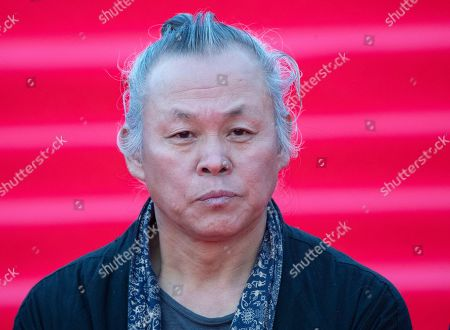 Chairman of jury South Korean director Kim Ki-duk pose during the opening ceremony of the 41st Moscow International Film Festival in Moscow, Russia