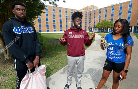 Larry Sykes, Stefan Young, Beronique Martin. Stefan Young, left, a senior accounting major, and Beronique Martin, a junior chemistry major, right, listen, as Larry Sykes, a Jackson State University senior majoring in business administration, stands outside Alexander Hall, and expresses his displeasure with the College Board raising tuition at all of the state's public universities for the fall. Sykes works so he can pay his own tuition. Mississippi's eight public universities plan to raise tuition by an average of 4% next fall, saying state funding increases this year are earmarked for increasing employee costs and they need more money to maintain programs