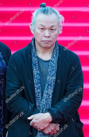 Stock Image of Chairman of jury South Korean director Kim Ki-duk pose during the opening ceremony of the 41st Moscow International Film Festival in Moscow, Russia