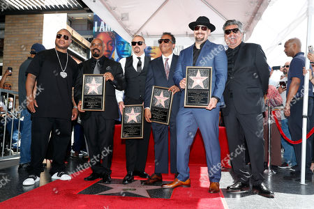 Xzibit (L) and US Comedian George Lopez (R) pose with Cypress Hill group members, Sen Dog, B Real, Eric 'Bobo' Correa and DJ Muggs after they unveiled their Star on the Hollywood Walk of Fame in Hollywood, California, USA, 18 April 2019. Cypress Hill is the first Latino American Hip Hop group to be honored with a star. The 2,660th star was dedicated in the Category of Recording.