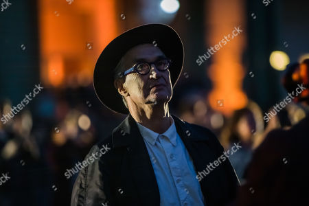Wim Wenders looks at a projection of his 'Unidentified Plastic Object', a monumental cinematographic installation based on his entire film work, projected on the interior structure of the Nave of the Grand Palais in Paris, France, 18 April 2019. The exhibition will run from 18 to 22 April 2019.