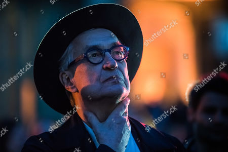 Stock Photo of Wim Wenders looks at a projection of his 'Unidentified Plastic Object', a monumental cinematographic installation based on his entire film work, projected on the interior structure of the Nave of the Grand Palais in Paris, France, 18 April 2019. The exhibition will run from 18 to 22 April 2019.