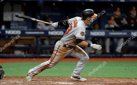 Baltimore Orioles' Joey Rickard watches his RBI double off Tampa Bay Rays relief pitcher Diego Castillo during the 11th inning of a baseball game, in St. Petersburg, Fla. Chris Davis scored