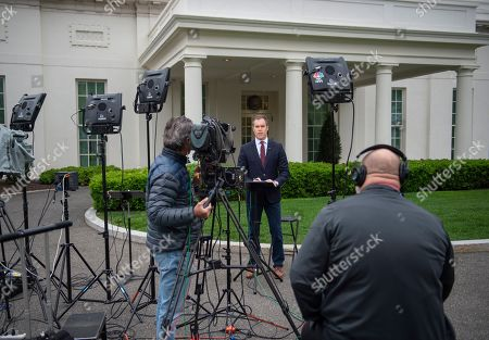 NBC News White House Correspondent Peter Alexander reports in front of the White House West Wing