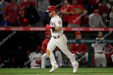Los Angeles Angels' Kole Calhoun rounds the bases after hitting a two-run home run during the seventh inning of a baseball game against the Seattle Mariners, in Anaheim, Calif