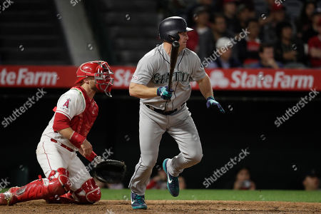 Seattle Mariners' Jay Bruce watches after hitting an RBI single during the ninth inning of a baseball game against the Los Angeles Angels, in Anaheim, Calif. The Mariners won 11-10