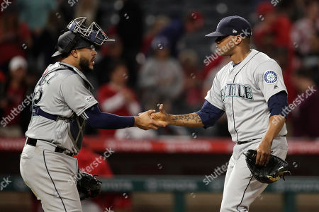 Roenis Elias, Omar Narvaez. Seattle Mariners starting pitcher Roenis Elias, left, and catcher Omar Narvaez shake hands after the team's 11-10 win over the Los Angeles Angels in a baseball game, in Anaheim, Calif