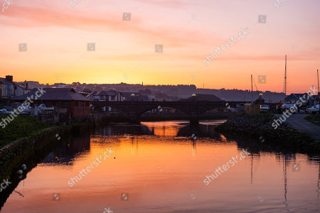 Dawn breaks over the harbour and marina in Aberystwyth on the west wales coast at the start of what promises to be a glorious Good Friday, as the country looks forward to the long Easter Bank Holiday weekend.