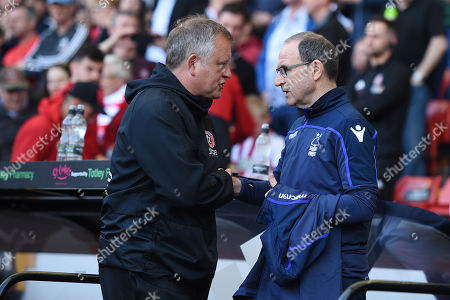 Chris Wilder manager of Sheffield United shakes hands with Martin O'Neill Manager of Nottingham Forest.