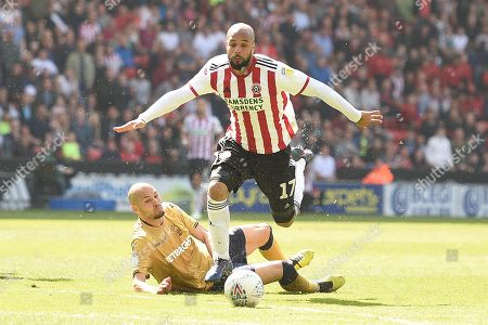 Yohan Benalouane of Nottingham Forest trips David McGoldrick of Sheffield United and ends up and gets sent off.
