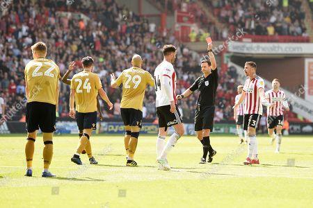 Stock Photo of Referee Andrew Madley send off Yohan Benalouane of Nottingham Forest.
