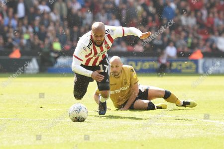 Stock Image of Yohan Benalouane of Nottingham Forest trips David McGoldrick of Sheffield United and ends up and gets sent off.