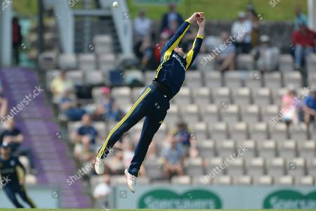 Mason Crane of Hampshire attempts tp take a catch off his own bowling during the Royal London 1 Day Cup match between Hampshire County Cricket Club and Glamorgan County Cricket Club at the Ageas Bowl, Southampton