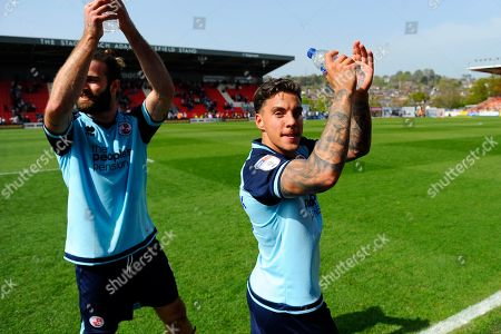 Reece Grego-Cox (7) of Crawley Town and Joe McNerney (5) of Crawley Town  celebrate at full time after a 3-1 win during the EFL Sky Bet League 2 match between Exeter City and Crawley Town at St James' Park, Exeter