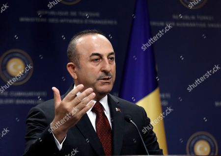Turkish Foreign Minister Mevlut Cavusoglu speaks to the media during a news conference with Polish Foreign Minister Jacek Czaputowicz and Romanian Foreign Minister Teodor Melescanu following a meeting of political-military consultations between the NATO countries, in Ankara, Turkey, . Cavusoglu says the United States has yet to respond to a Turkish proposal to set up a technical committee to review possible security threats Russia's S-400 missile defense system could pose to the U.S. F-35 fighter jet program