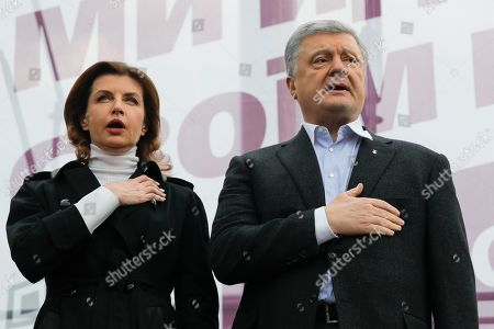 Petro Poroshenko, Maryna Poroshenko. Ukrainian President Petro Poroshenko, right, and his wife Maryna sing the national anthem as supporters gather to march to the Olympic stadium ahead of debates between two candidates in the weekend presidential run-off in Kiev, Ukraine, . Friday is the last official day of election canvassing in Ukraine as all presidential candidates and their campaigns will be barred from campaigning on Saturday, the day before the vote