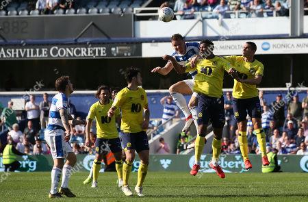 Matt Smith of QPR heads with Joe Nuttall of Blackburn Rovers & Jack Rodwell of Blackburn Rovers