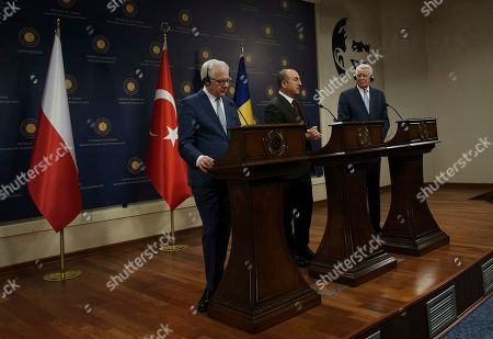 Mevlut Cavusoglu, Jacek Czaputowicz, Teodor Melescanu. Turkish Foreign Minister Mevlut Cavusoglu, centre, Polish Foreign Minister Jacek Czaputowicz, left, and Romanian Foreign Minister Teodor Melescanu speak to the media during a joint news conference following a meeting of political-military consultations between the NATO countries, in Ankara, Turkey