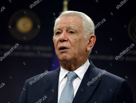 Romanian Foreign Minister Teodor Melescanu speaks to the media after a meeting of political-military consultations between the NATO countries with Turkish Foreign Minister Mevlut Cavusoglu and Polish Foreign Minister Jacek Czaputowicz, in Ankara, Turkey