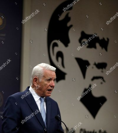 Stock Photo of Backdropped by an image of Turkey's founder Mustafa Kemal Ataturk, Romanian Foreign Minister Teodor Melescanu speaks to the media after a meeting of political-military consultations between the NATO countries with Turkish Foreign Minister Mevlut Cavusoglu and Polish Foreign Minister Jacek Czaputowicz, in Ankara, Turkey