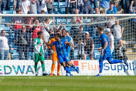 Gillingham FC midfielder Regan Charles-Cook (11) scores a goal (1-1) and celebrates with team mates during the EFL Sky Bet League 1 match between Gillingham and Plymouth Argyle at the MEMS Priestfield Stadium, Gillingham