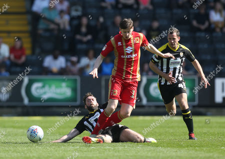 Notts County's Jim O'Brien tackles with MK Dons Conor McGrandles
