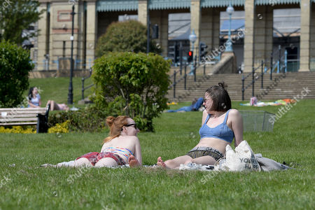 Visitors enjoy a very warm Good Friday by taking to novelty boats and relaxing in the sun in the park and gardens at Alexandra Palace, North London.