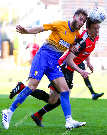 Andrew Fleming of Morecambe beats Jorge Grant of Mansfield Town to the ball