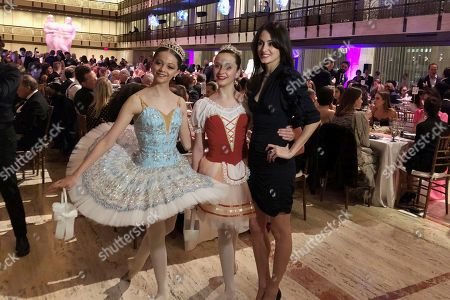 """Choreographer Melanie Hamrick poses with dancers at the gala of Youth America Grand Prix, the world's largest ballet scholarship competition, on Thursday, April 18, after the U.S. premiere of her new ballet, """"Porte Rouge"""" (Red Door), based on classic Rolling Stones tunes arranged by her partner, Mick Jagger. The Stones frontman, recovering from medical treatment, watched from backstage and addressed the audience briefly via microphone before the show"""