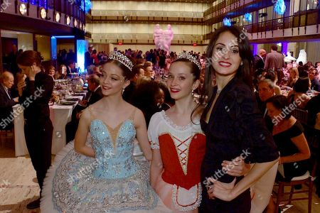 """In this still image from video, choreographer Melanie Hamrick poses with dancers at the gala of Youth America Grand Prix, the world's largest ballet scholarship competition, on Thursday, April 18, after the U.S. premiere of her new ballet, """"Porte Rouge"""" (Red Door), based on classic Rolling Stones tunes arranged by her partner, Mick Jagger. The Stones frontman, recovering from medical treatment, watched from backstage and addressed the audience briefly via microphone before the show"""