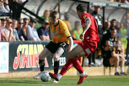 Hayden Coulson of Cambridge United and Marc Richards of Swindon Town during Cambridge United vs Swindon Town, Sky Bet EFL League 2 Football at the Cambs Glass Stadium on 19th April 2019