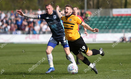 Stock Image of Ben Kennedy of Newport County is tackled by Nicky Adams of Bury.