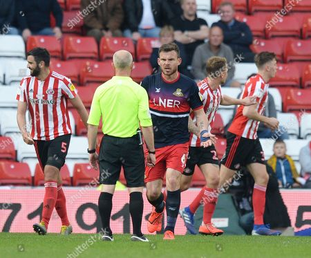 Andrew Butler of Doncaster Rovers appeals for a decision from the referee after being pulled down in the penalty box