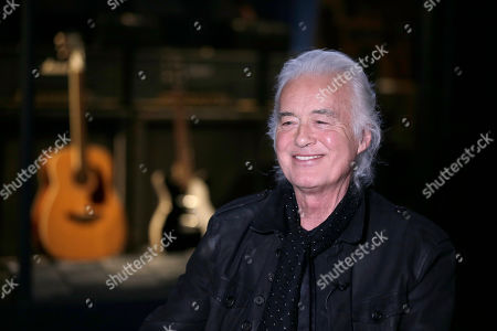 """Jimmy Page speaks to a reporter at the Metropolitan Museum of Art in New York, . Some of the instruments that Page used to create his Led Zeppelin sound are on display an exhibition called """"Play It Loud: Instruments of Rock & Roll"""" at the Metropolitan Museum of Art in New York"""
